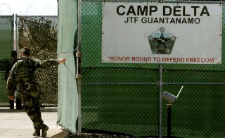 A U.S. Army soldier closes the gate at maximum security prison Camp Delta at Guantanamo Naval Base on Aug. 25, 2004 in Guantanamo, Cuba. An unusual alliance of both Republican lawmakers and liberal-leaning advocacy groups agree that moving some Gitmo detainees to U.S. soil doesn't end the Obama administration's policy of indefinite detention. Photo by Mark Wilson/Reuters liberal-leaning advocacy groups