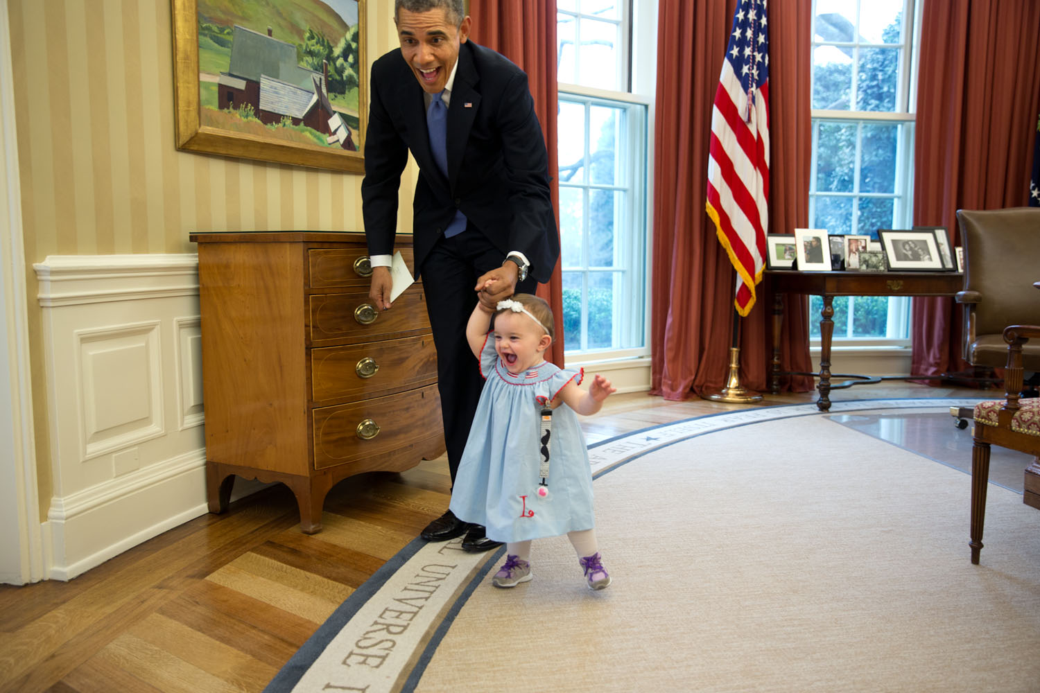 This moment happened when former Deputy Press Secretary Jamie Smith and her family, including one-year-old Rose Smith, stopped by for a departure greet and photograph with the president. Official White House photo by Pete Souza.