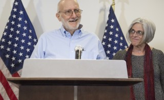 Alan Gross, alongside his wife Judy,speaks at a press conference after being released by Cuba on Dec. 17, 2014. Gross, an American contractor jailed on the communist-ruled island since 2009, was released amid signs of an imminent thaw in ties between the Cold War foes. Photo by Saul Loeb/AFP/Getty Images