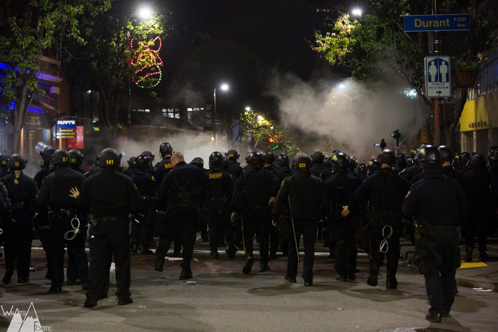 Police deploy tear gas as they advance South on Telegraph Avenue in Berkeley. Photo by Kevin Foote.