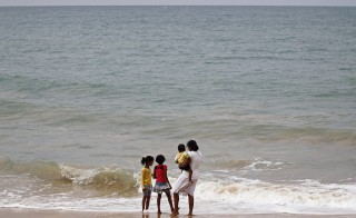 Years after the 2004 Indian Ocean tsunami, researchers found an increase in the fertility rate. Above, The family of a victim looks out to sea on the 10th anniversary of the Indian Ocean tsunami in Pereliya December 26, 2014. Photo by REUTERS/Dinuka Liyanawatte.
