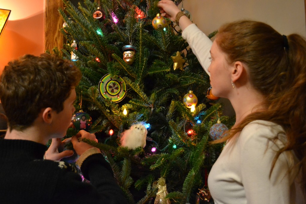 Ben and Aimee Miller decorate their family's Christmas tree. Their mother, Susan Katz Miller, is a journalist, blogger and author who writes about interfaith families, including her own. Photo courtesy of Susan Katz Miller.