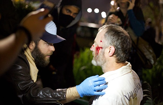 A wounded protester is tended by another protester during Sunday night's protest. Photo by Rachael Garner/Daily Californian