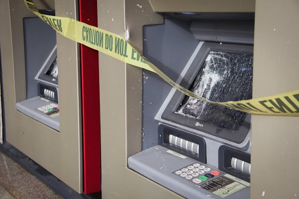 ATM machine screens smashed during Sunday night's protest. Photo by Ariel D. Hayat/Daily Californian