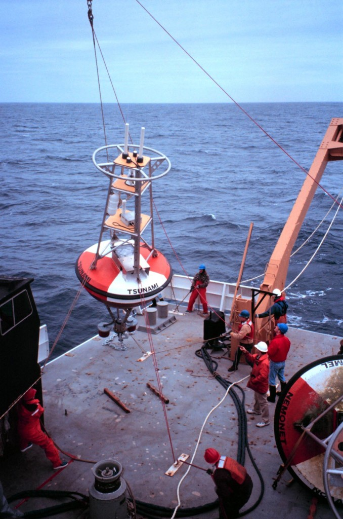 NOAA deploys a buoy in the Pacific Ocean to send real-time sea level data to tsunami warning centers. Courtesy: NOAA