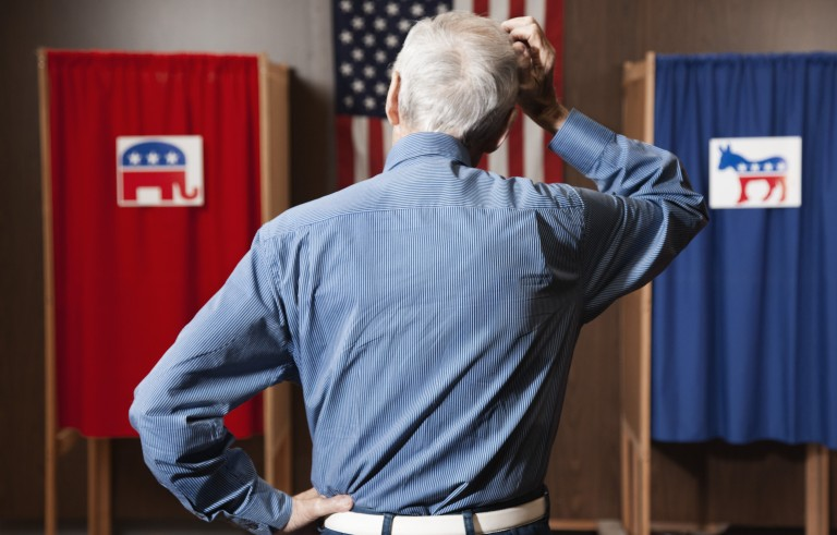A voter waits to vote in a polling place. Image by Brand X Pictures/ Getty Images