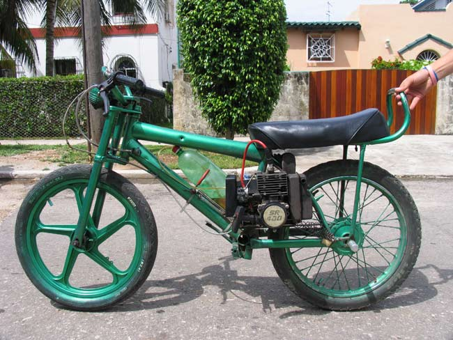 The rikimbili, prohibited, but widely used in Cuba, is made of a bicycle with a motor attached. Photo by Ernesto Oroza