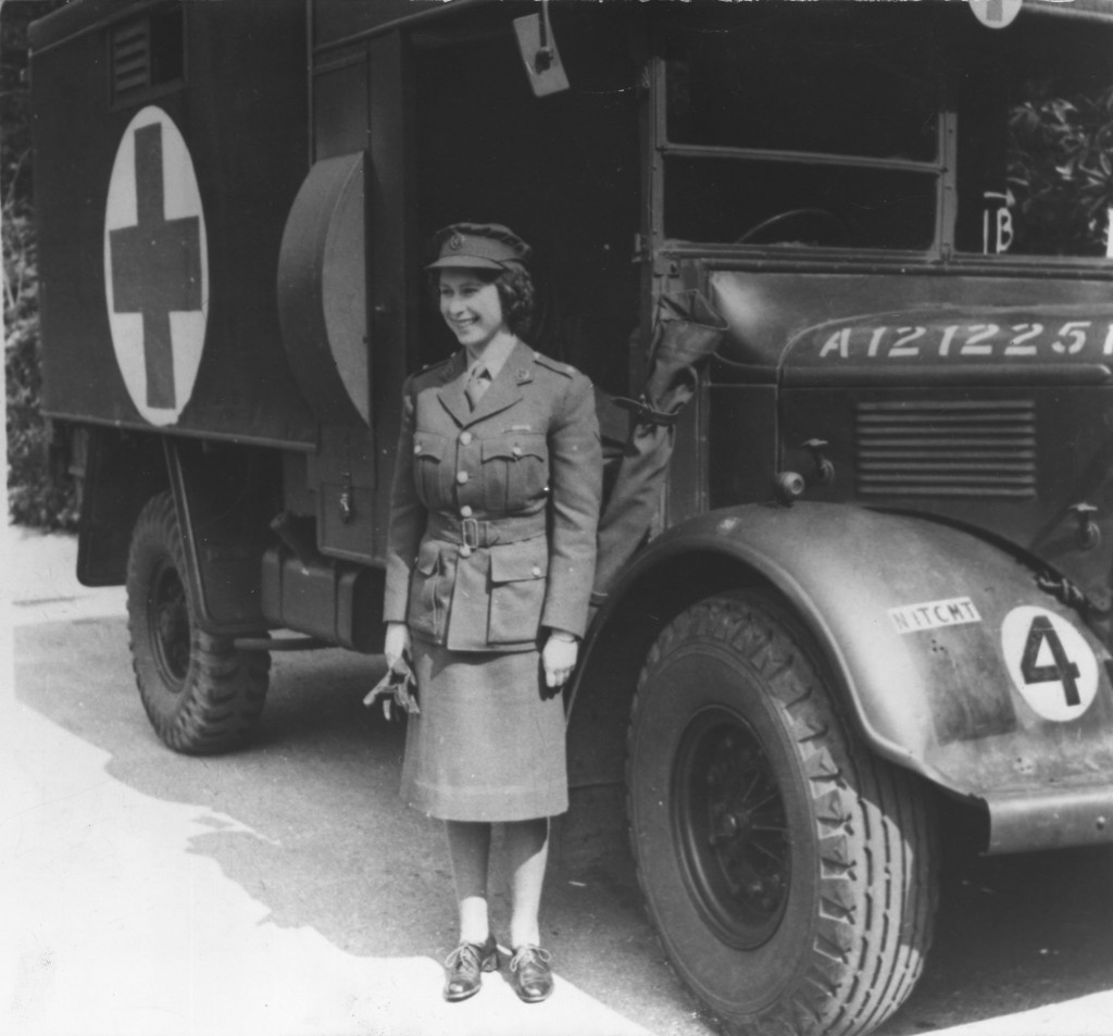Princess Elizabeth, in 1945, standing by an Auxiliary Territorial Service first aid truck wearing an officer's uniform. Photo by Keystone/Getty Images