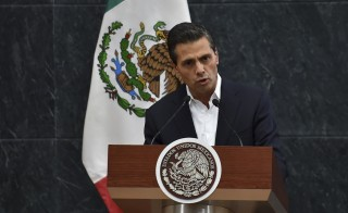Mexico's President Enrique Pena Nieto delivers a message to the press after a meeting with parents of 43 missing students at the Los Pinos presidential palace in Mexico City on Oct. 29, 2014. Photo by Yuri Cortez/AFP/Getty Images