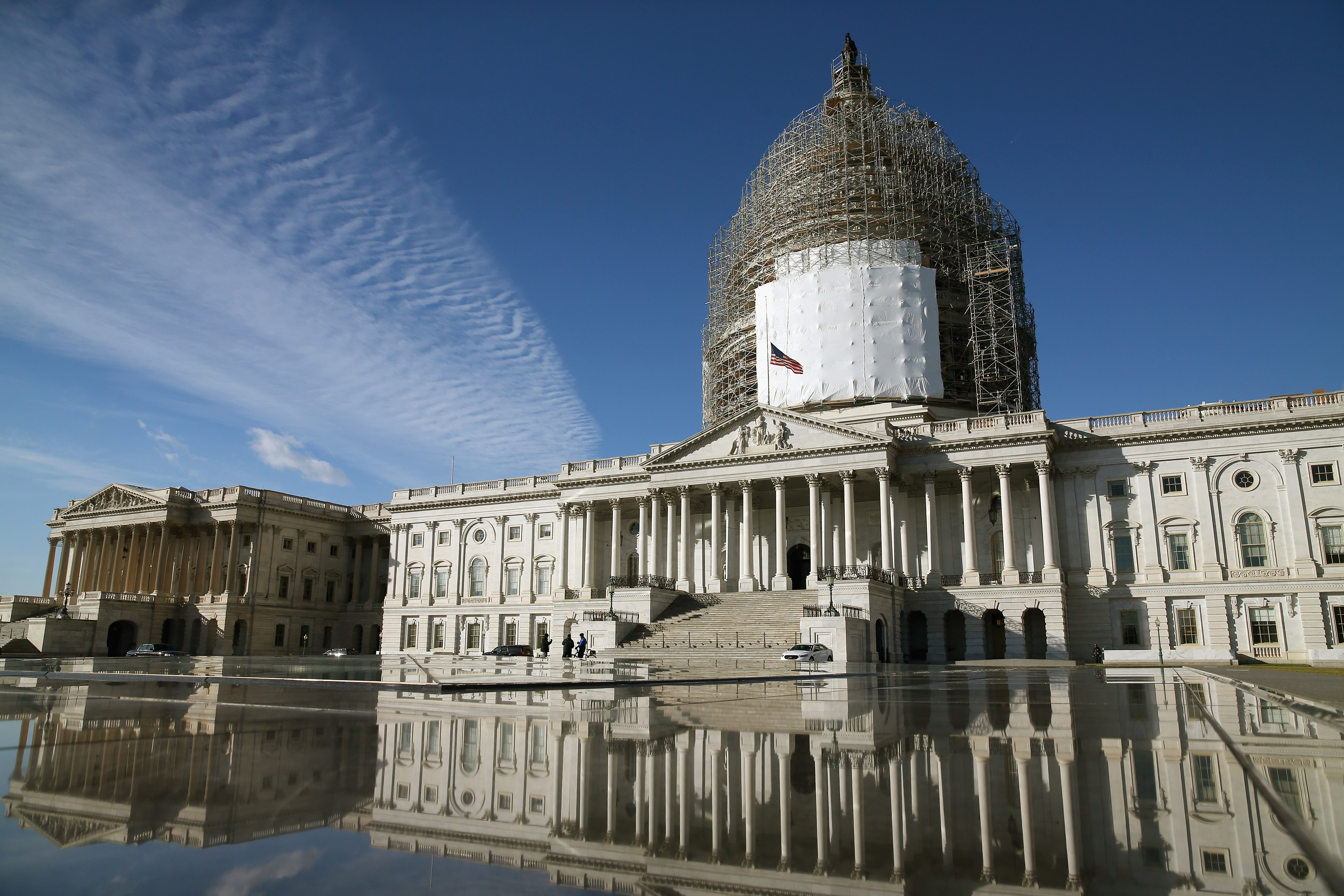 The US Capitol is reflected in a fountain, January 5, 2015 in Washington, DC. Congress is set to tackle Medicare issues, the Iran nuclear deal, and Loretta Lynch. Photo by Mark Wilson/Getty Images.