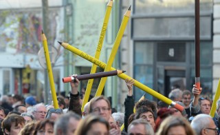 "People hold giant pencil-shaped objects reading in French ""Freedom""  during a rally in Marseille, southeastern France, on January 10, 2015, as tens of thousands of people staged rallies across France following three days of terror and twin siege dramas that claimed 17 victims, including the victims of the first attack by armed gunmen on the offices of French satirical newspaper Charlie Hebdo in Paris on January 7.  AFP PHOTO / BORIS HORVAT        (Photo credit should read BORIS HORVAT/AFP/Getty Images)"
