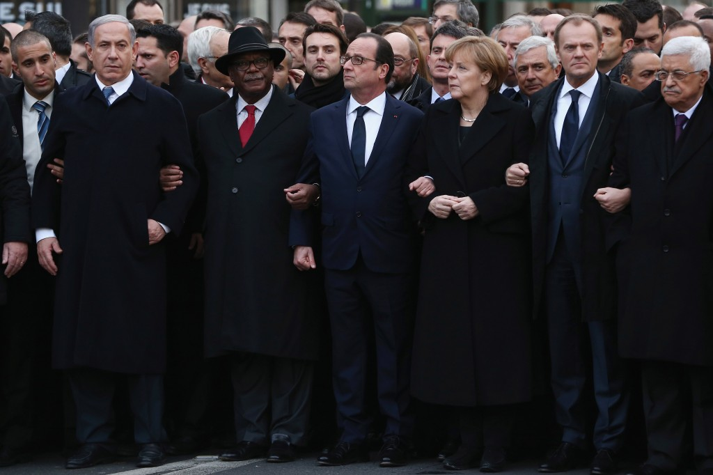 PARIS, FRANCE - JANUARY 11:  Demonstrators gather in Place de la Republique prior to a mass unity rally to be held in Paris following the recent terrorist attacks on January 11, 2015 in Paris, France. An estimated one million people are expected to converge in central Paris for the Unity March joining in solidarity with the 17 victims of this week's terrorist attacks in the country. French President Francois Hollande will lead the march and will be joined by world leaders in a sign of unity. The terrorist atrocities started on Wednesday with the attack on the French satirical magazine Charlie Hebdo, killing 12, and ended on Friday with sieges at a printing company in Dammartin en Goele and a Kosher supermarket in Paris with four hostages and three suspects being killed. A fourth suspect, Hayat Boumeddiene, 26, escaped and is wanted in connection with the murder of a policewoman.  (Photo by Dan Kitwood/Getty Images)