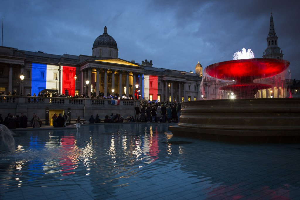 LONDON, ENGLAND - JANUARY 11:  The National Gallery is lit in the blue, white and red colours of the national flag of France in tribute to the victims of the terrorist attacks in Paris on January 11, 2015 in London, England. The terrorist atrocities started on Wednesday with the attack on the French satirical magazine Charlie Hebdo, killing 12, and ended on Friday with sieges at a printing company in Dammartin en Goele and a Kosher supermarket in Paris with four hostages and three suspects being killed. A fourth suspect, Hayat Boumeddiene, 26, escaped and is wanted in connection with the murder of a policewoman.  (Photo by Rob Stothard/Getty Images)