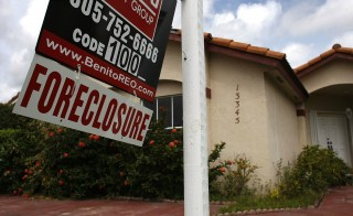 MIAMI - MARCH 04:  A foreclosure sign hangs in front of a home March 4, 2008 in Miami, Florida. Federal Reserve Chairman Ben Bernanke called for additional action to help prevent homeowners from falling into foreclosure during a speech in Florida. Foreclosures in Florida jumped at more than double the nationwide pace, rising 158 percent in the past year, according to RealtyTrac.  (Photo by Joe Raedle/Getty Images)