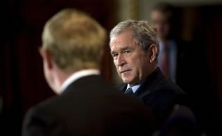 President George W. Bush makes remarks at the American Enterprise Institute Washington, DC in December 2008.     AFP PHOTO/Jim WATSON