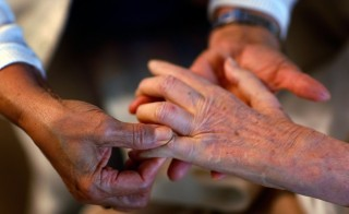 Nearly 40 million Americans provide care for adult friends or relatives, according to a new report from AAPR and the National Aliance for Caregiving. (Photo by Joe Raedle/Getty Images