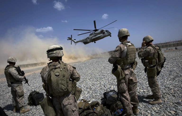 Marines wait to board a CH-53 helicopter as it lands at a forward operating base in Helmand Province, southern Afghanistan, in 2009. The 2016 defense spending bill Photo by David Furst/AFP/Getty Images