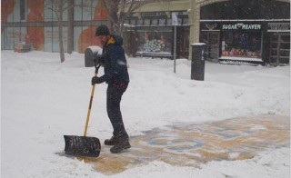 Bay Bay Social Club bartender Christopher Laudani shoveled the Boston Marathon finish line on Jan. 27, 2015. Photo by Adam Reynolds.