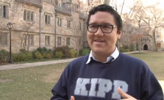 George Ramirez, a senior at Yale, talks to Paul Solman at Yale. NewsHour still image.