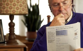 A man examines his Social Security paperwork. A new internal watchdog report released that Social security does not hold death records of more than 6 million people. The social security numbers are still active, which could be used to report wages, open bank accounts, obtain credit cards or claim fraudulent tax refunds. Photo by Jim McGuire/Getty Images.
