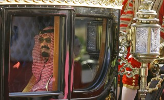 Saudi Arabia's King Abdullah rides in a carriage as he leaves Horse Guards, London, after a ceremonial welcome on Oct. 30, 2007. State media reported late Thursday that the Saudi King had died at the age of 90.