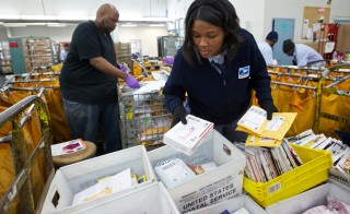 United States Postal Service, USPS, Letter Carrier Lakesha Dortch-Hardy sorts mail at the Lincoln Park carriers annex in Chicago, Nov. 29, 2012. Photo by John Gress/Reuters