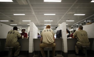 Inmates are processed at the Cook County Jail in Chicago, Illinois, May 20, 2014. More than 5,000 jail inmates have signed up for Medicaid under a program that lets them apply while incarcerated. Picture taken May 20, 2014. REUTERS/Jim Young (UNITED STATES - Tags: HEALTH) - RTR426MW