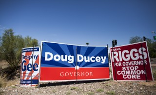 Political signs in Arizona. Photo by Samantha Sais/Reuters