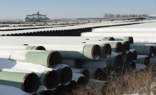 A depot used to store pipes for Transcanada Corp's planned Keystone XL oil pipeline is seen in Gascoyne, North Dakota November 14, 2014. The Republican-led U.S. House of Representatives approved the Keystone XL pipeline on Friday, but a similar measure struggled to get enough support in the Senate and President Barack Obama indicated he might use his veto if the bill does get through Congress.  Photo by Andrew Cullen/Reuters