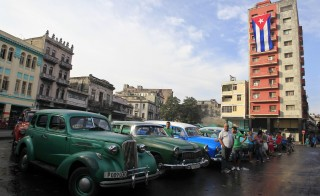 Vintage cars used as taxis are parked on a street in Havana Dec. 26, 2014. Around 60,000 vintage cars have run on Cuba's roads since before the 1959 revolution led by Fidel Castro.  the U.S. embargo has blocked countless more from visiting a country just 90 miles south of Florida. President Barack Obama's decision last month to improve relations with Cuba and ease trade and travel rules to the island has changed all of that. Credit:     Stringer/REUTERS