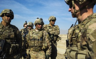 U.S. soldiers from Dragon Troop of the 3rd Cavalry Regiment discuss their mission during their first training exercise of the new year near operating base Gamberi in the Laghman province of Afghanistan