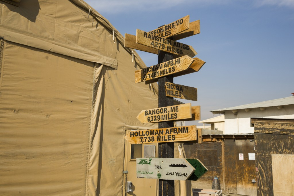 photo essay remnants of the trillion dollar war in  sign posts declaring the distance from bagram air field to various u s bases across the world