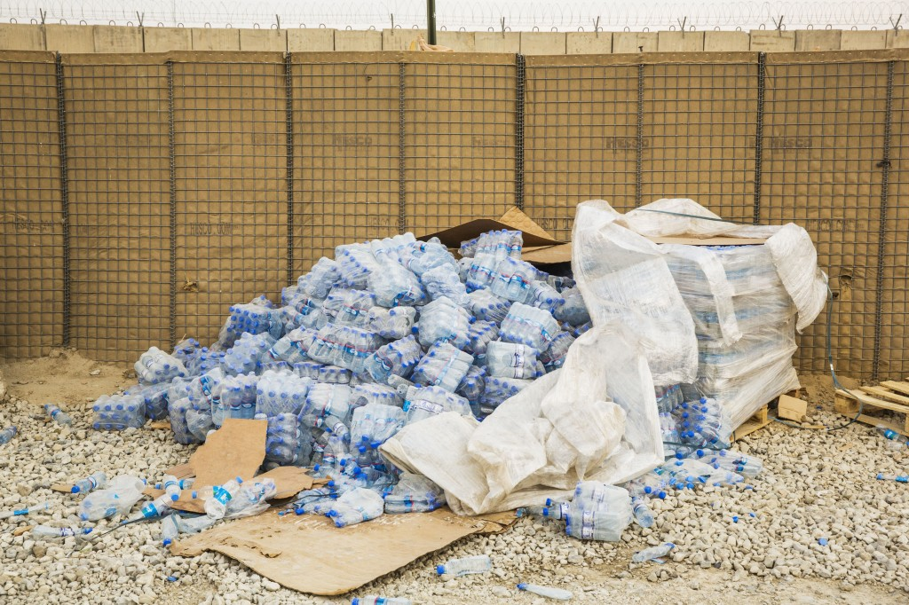 photo essay remnants of the trillion dollar war in  cases of water bottles cascade out of shrink wrap in an area waiting to be cleared