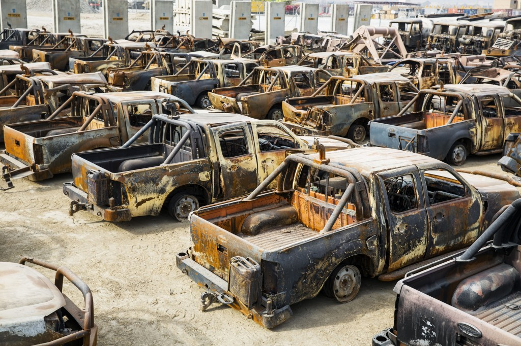 photo essay remnants of the trillion dollar war in  burned afghan national army trucks wait to be demolished on the massive bagram air field in