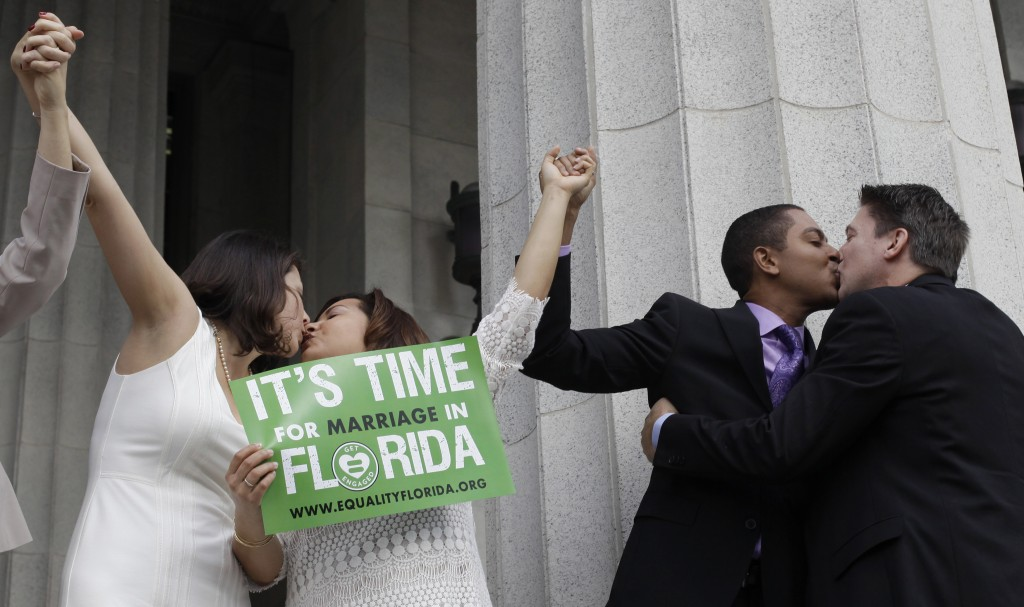 From right to left; Jeff Delmay, Todd Delmay, Karla Arguello and Catherina Pareto kiss after the same-sex couples were married in Miami, Florida, January 5, 2015. A judge ruled same-sex marriages could begin in Miami-Dade County on Monday, just ahead of gay couples being able to tie the knot statewide after midnight when Florida becomes the 36th U.S. state to allow people of the same sex to wed. Picture taken Jan. 5, 2015. Photo by Javier Galeano/Reuters