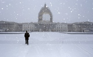 A light snow blankets the east front of the U.S. Capitol on Tuesday. John Boehner is expected to be re-elected as Speaker of the House as Congress convenes its new session. Photo by Jonathan Ernst/Reuters