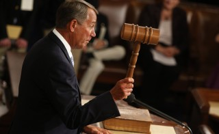 Rep. John Boehner wields the gavel after being re-elected as the Speaker of the House. Photo by Jim Bourg/Reuters