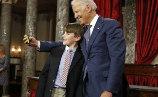 The grandson of U.S. Senator Jeanne Shaheen, A.J. Belladona, takes a selfie with VP Biden after Shaheen's ceremonial swearing-in at Capitol Hill in Washington