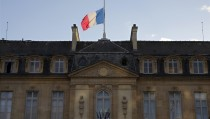 The French flag flies at half-mast above the Elysee Palace in a sign of mourning in Paris