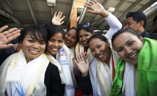 Members of a seven women summit team wave to media in Kathmandu after completing their quest to summit 7 of the world's highest peaks.