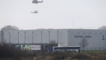 Helicopters with French intervention forces hover above the scene of a hostage taking at an industrial zone in Dammartin-en-Goele, northeast of Paris