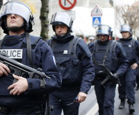 French intervention police take up position near the scene of a hostage taking at a kosher supermarket near Porte de Vincennes in eastern Paris January 9, 2015. Photo by Youssef Boudlal/Reuters