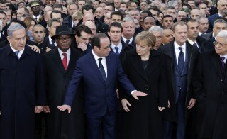 Israel's Prime Minister Benjamin Netanyahu (L), Mali's President Ibrahim Boubacar Keita (2ndL), French President Francois Hollande (C), Germany's Chancellor Angela Merke (4thL), European Council President Donald Tusk (5thL) and Palestinian President Mahmoud Abbas attend the solidarity march (Marche Republicaine) in the streets of Paris January 11, 2015. Presdient Obama was widely criticized for not sending a high-level representative to the march. Photo by Philippe Wojazer/Reuters