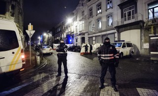 Belgian police block a street in central Verviers where Belgian counter-terrorist police raided an apartment