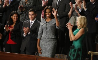 U.S. first lady Michelle Obama waves prior to President Obama's State of the Union address to a joint session of Congress on Capitol Hill in Washington