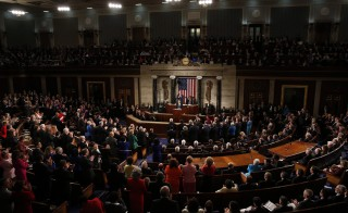 Democratic members of congress applaud President Barack Obama as he delivers his State of the Union address to a joint session of Congress.  Photo by Larry Downing/Reuters