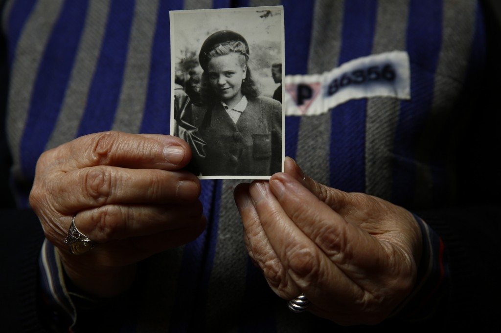Auschwitz concentration camp survivor Jadwiga Bogucka holds a picture of herself from 1944 in Warsaw