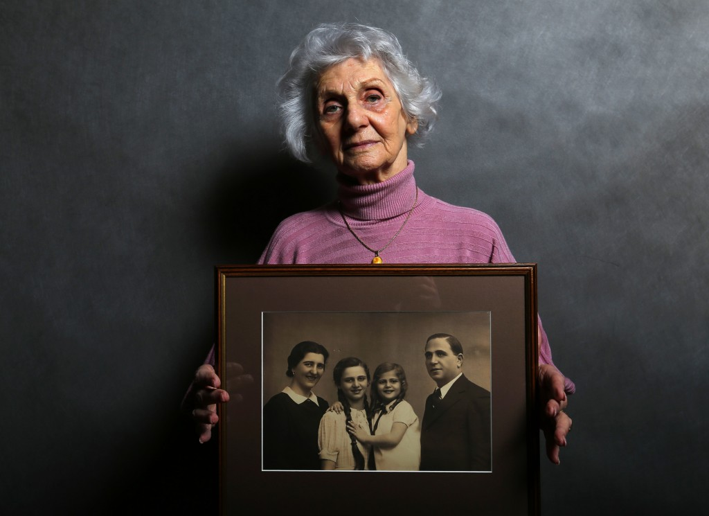 Auschwitz concentration camp survivor Eva Fahidi holds a picture of her family members, all of whom were killed in the concentration camp during World War II