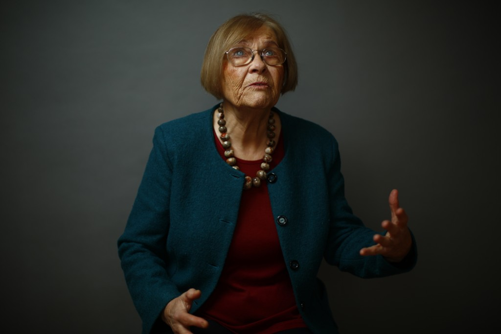 Auschwitz death camp survivor Elzbieta Sobczynska gestures as she poses for a portrait in Warsaw
