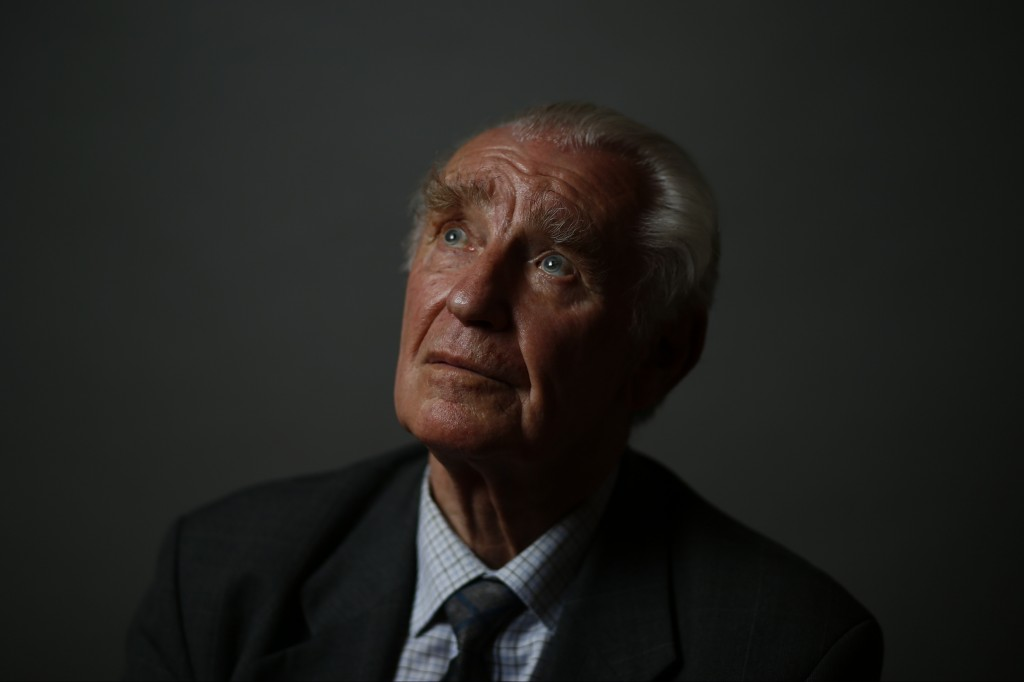 Auschwitz death camp survivor Jerzy Ulatowski poses for a photo in Warsaw